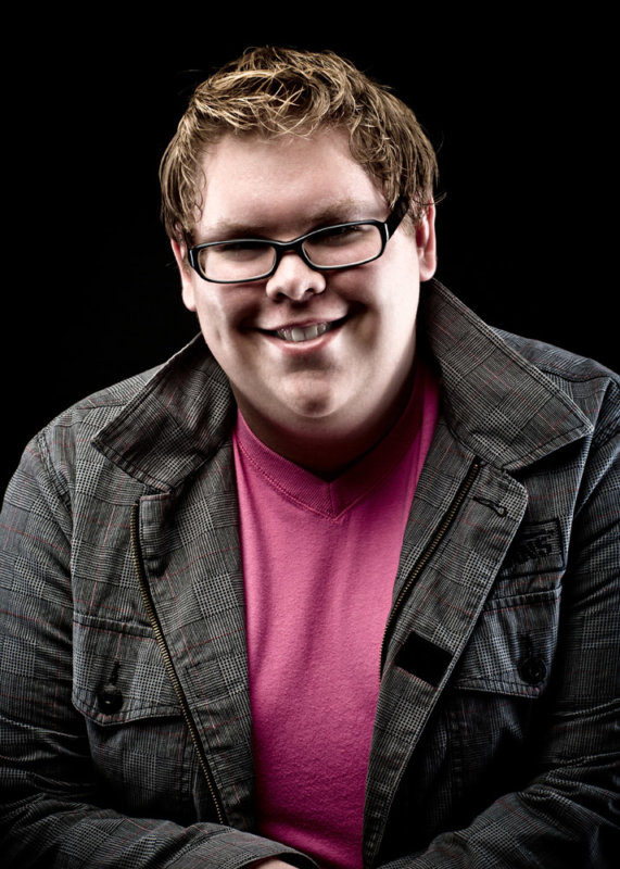 boy with pink shirt and cool lighting for senior picture