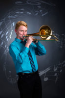 trombone player with musical notes in studio senior portrait