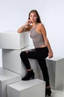 fashion portrait of girl and white blocks taken for senior photos