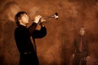 deering high school senior plays trumpet in photography studio