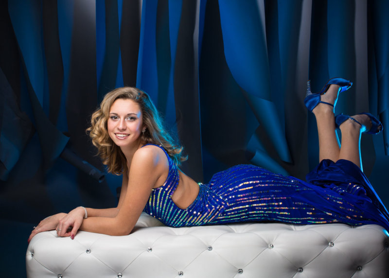 girl in sequined prom dress in senior photography studio in maine