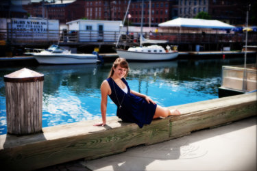 senior girl in front of waterfront in portland, me