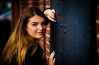 senior girl against door in old port photo shoot