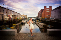 girl in white dress at portland's working waterfront in maine