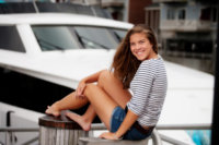 girl with stripes at portland's waterfront by large boat