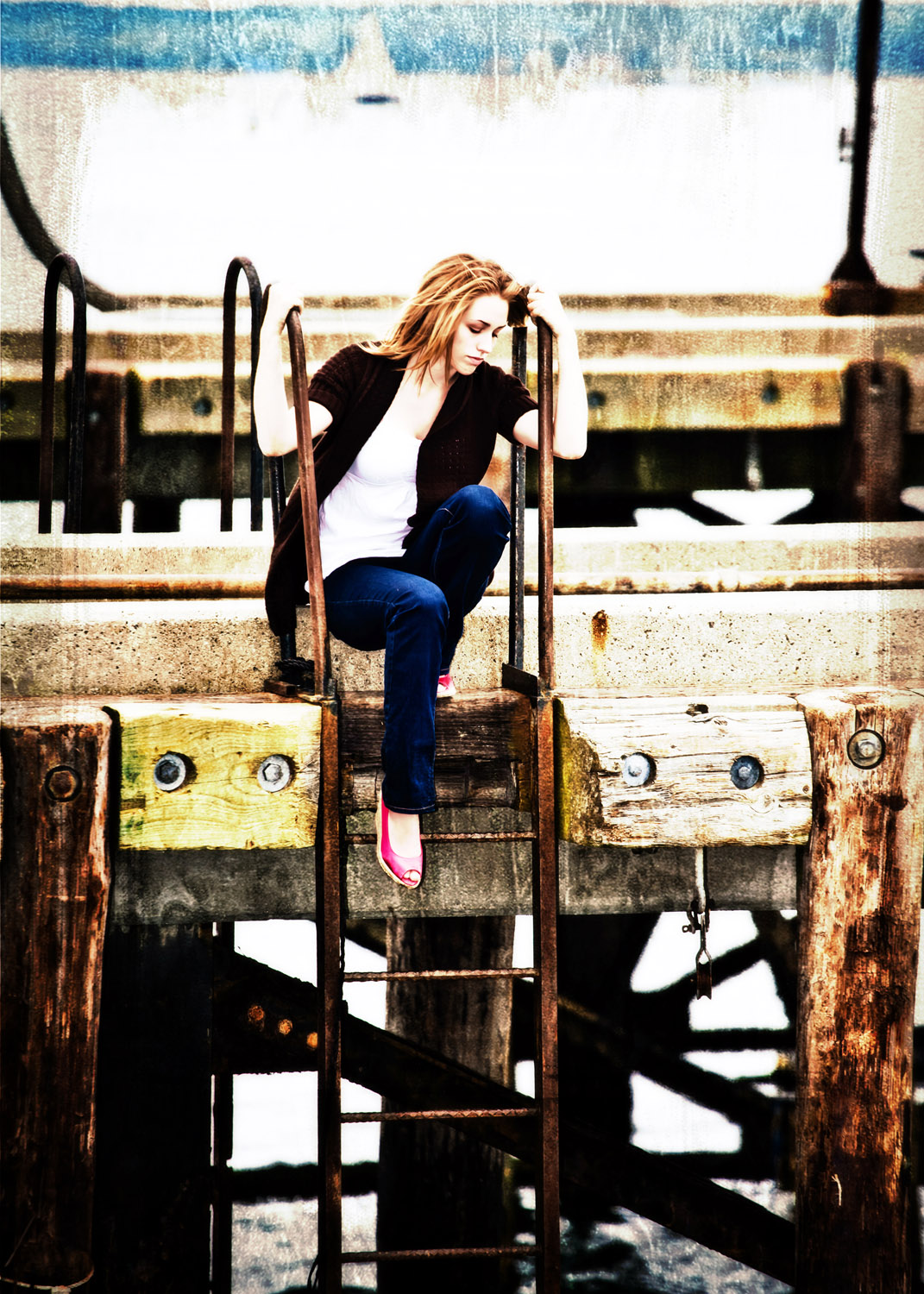 waterfront image of senior girl sitting on dock
