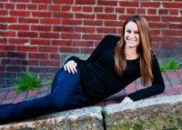 senior girl laying on sidewalk in portland photo shoot