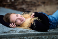 girl on marble railing for city photo shoot