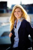 senior girl in blue blazer at portland's waterfront