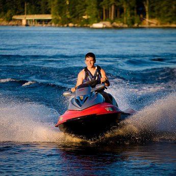Senior portrait on water craft jet ski