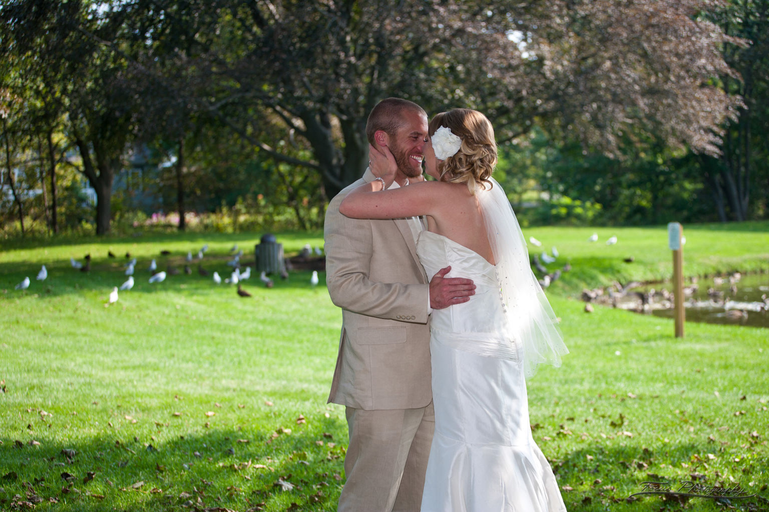 Bride and groom laughing at Maine park