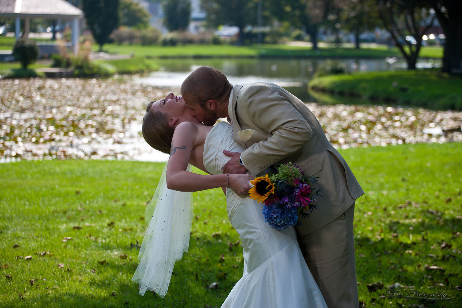 Groom kissing bride in South Portland Maine