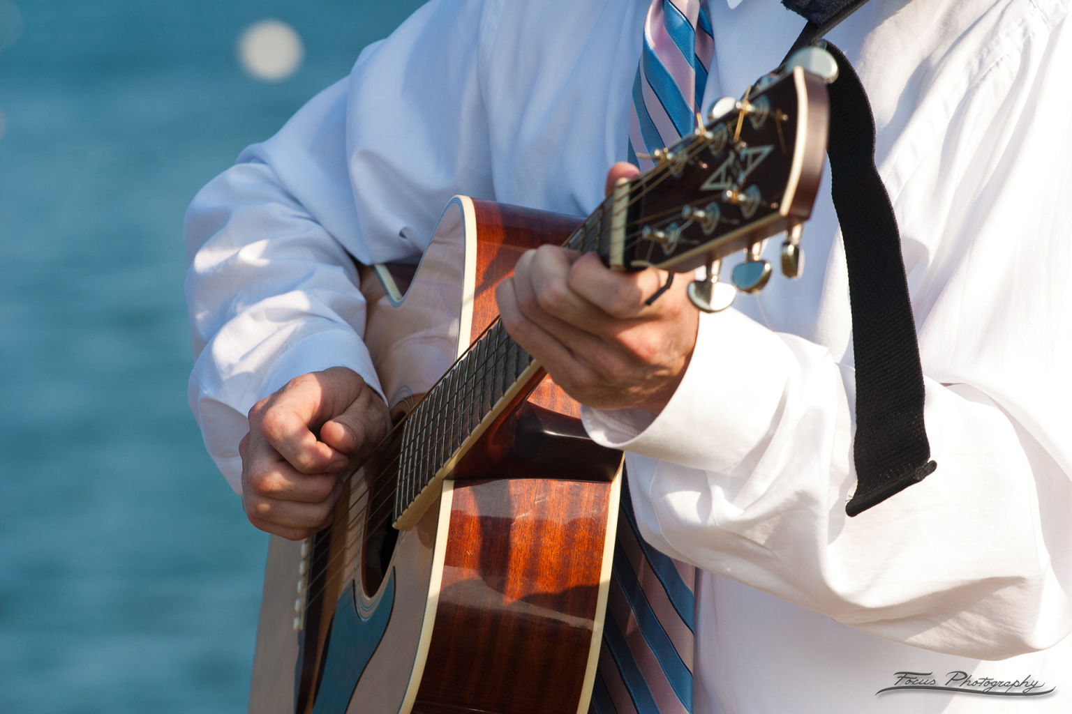 Playing guitar at Casco Bay Maine wedding
