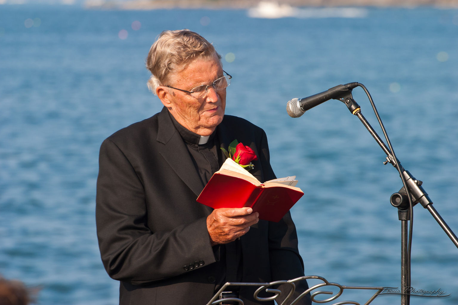Minister reading at Maine wedding