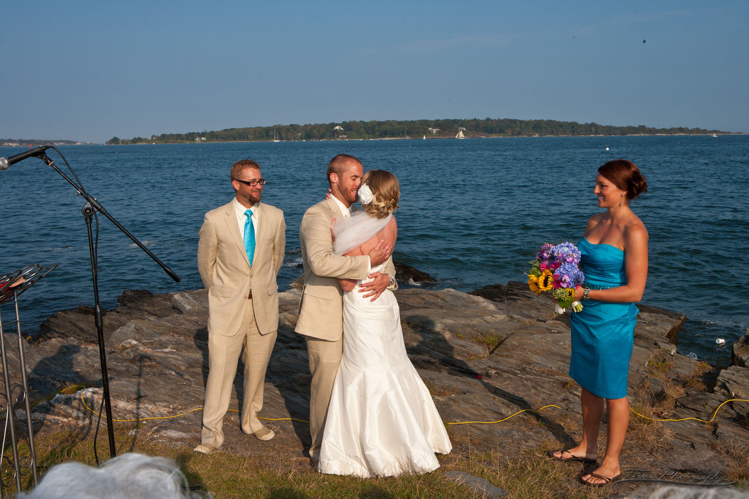 Bride and groom kissing at Casco Bay Maine wedding