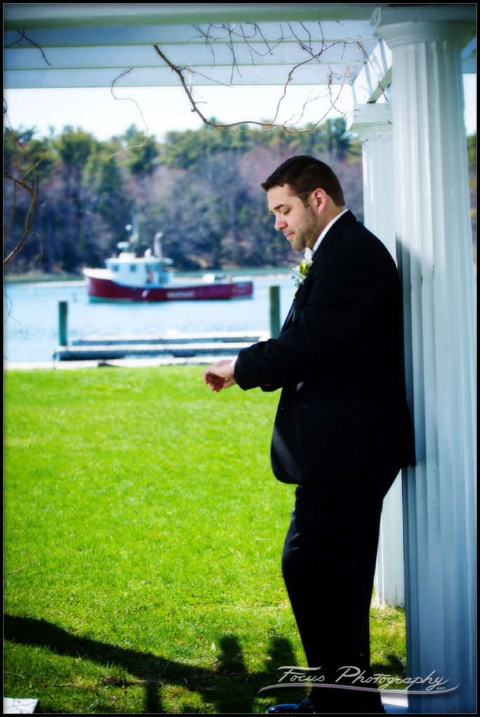 groom waiting by the harbor in Maine
