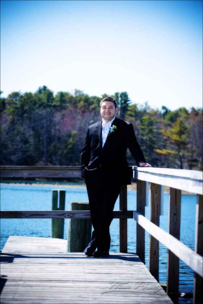 groom on docks in Kennebunkport Maine wedding
