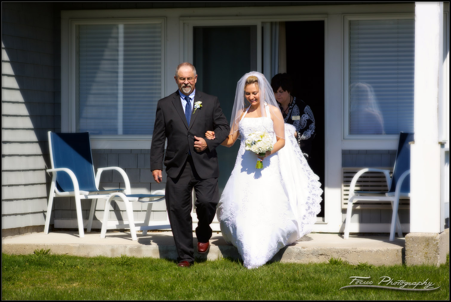 bride walks down aisle in ceremony during Maine wedding - photography by Focus