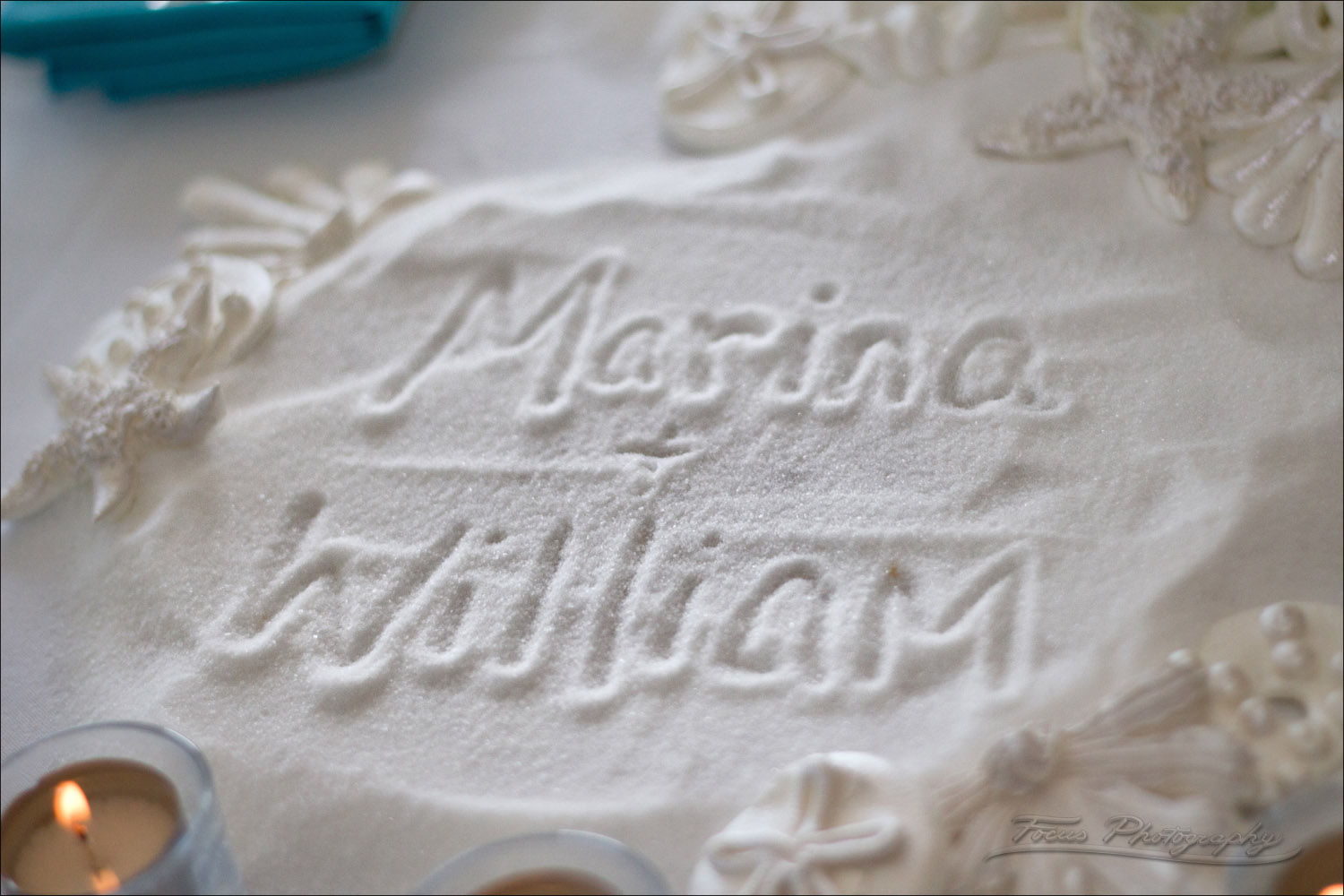sugar laid as sand in front of wedding cake