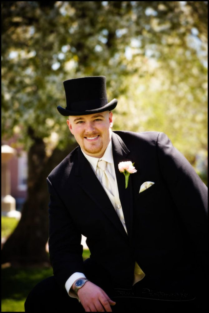 groom in top hat by north shore wedding photographers Focus Photography