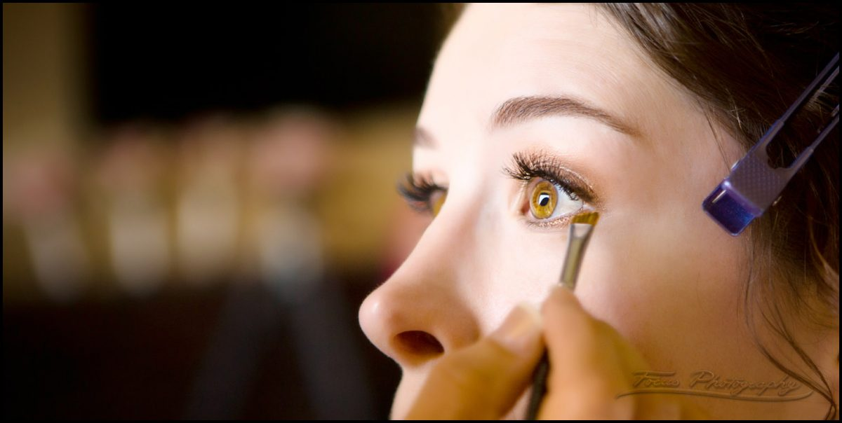 wedding makeup applied to bride's eyes