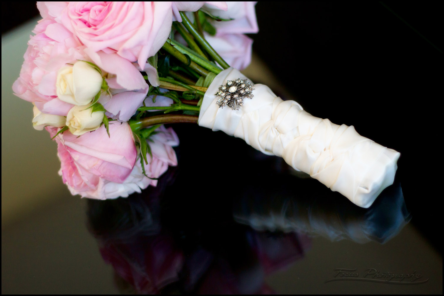 brooch on flower bouquet at wedding in Newburyport. Wedding photographers Focus Photography
