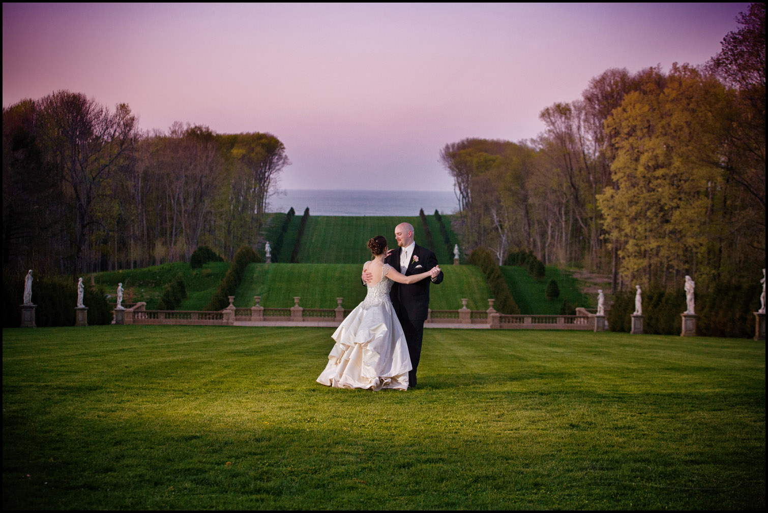 bride and groom dancing at grand allee at crane estate in Ipswich, Massachusetts