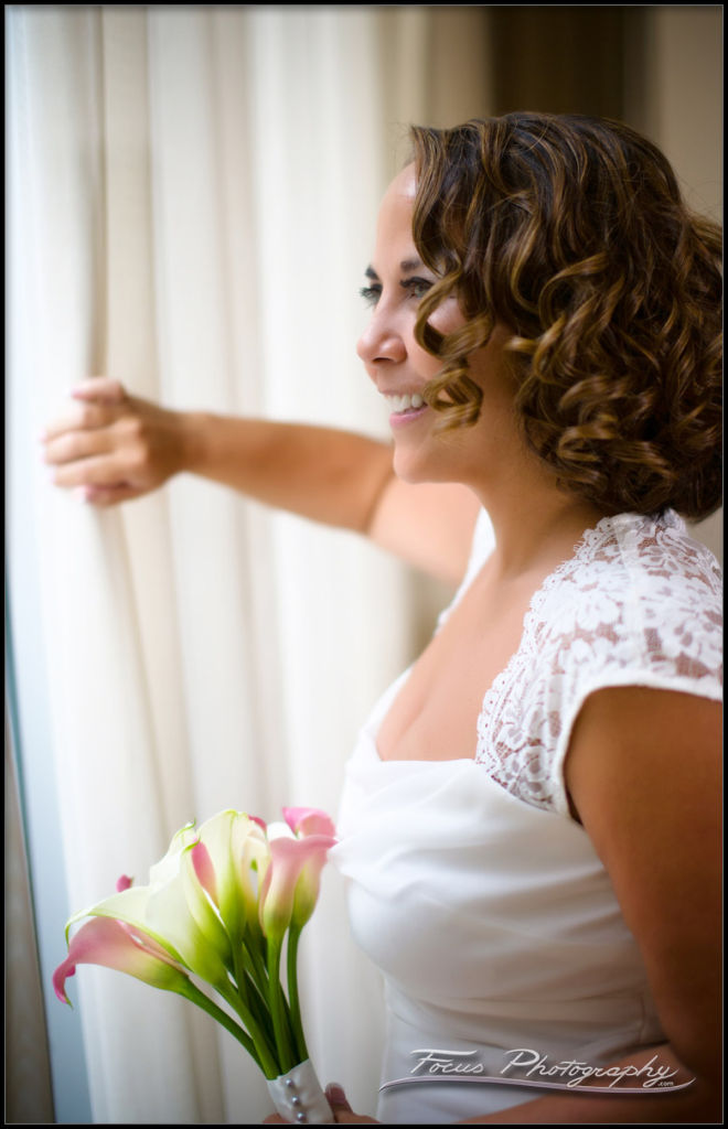 bride looking out at Portland Maine Wedding