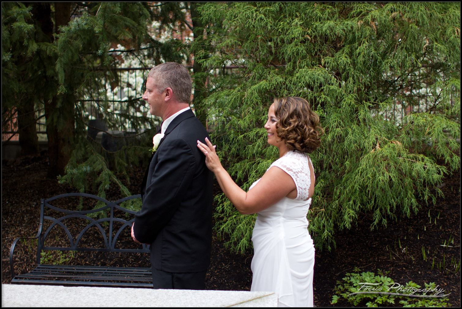Bride taps groom on shoulder before First Glance