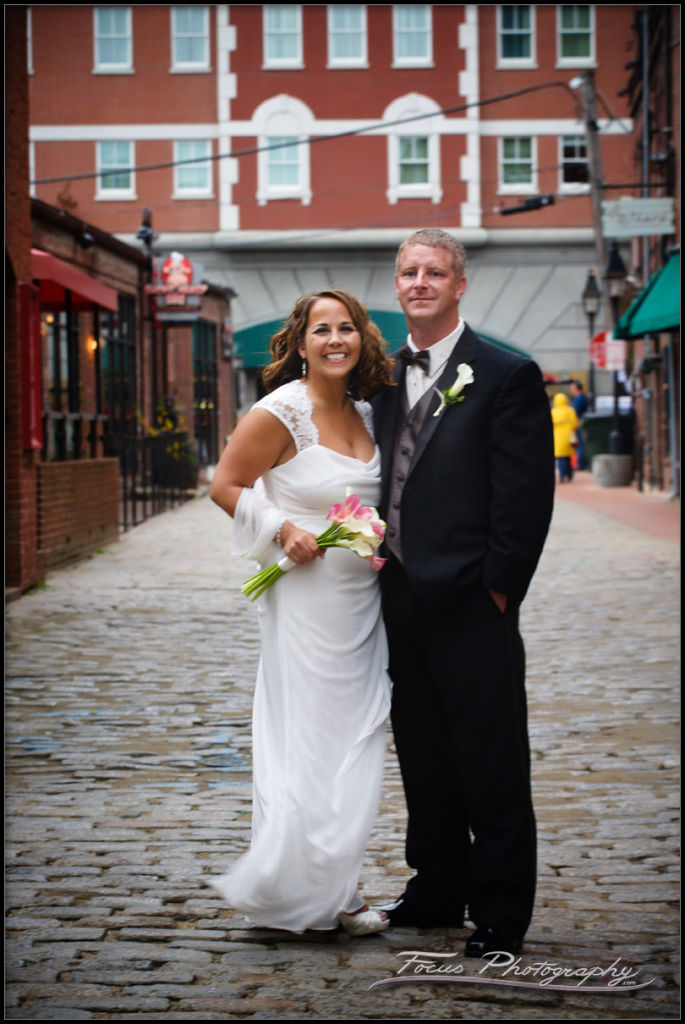 Full length image of a Bride and Groom on Wharf Street