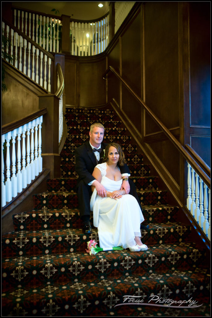 Bride and Groom on the stairs at the Portland Harbor Hotel