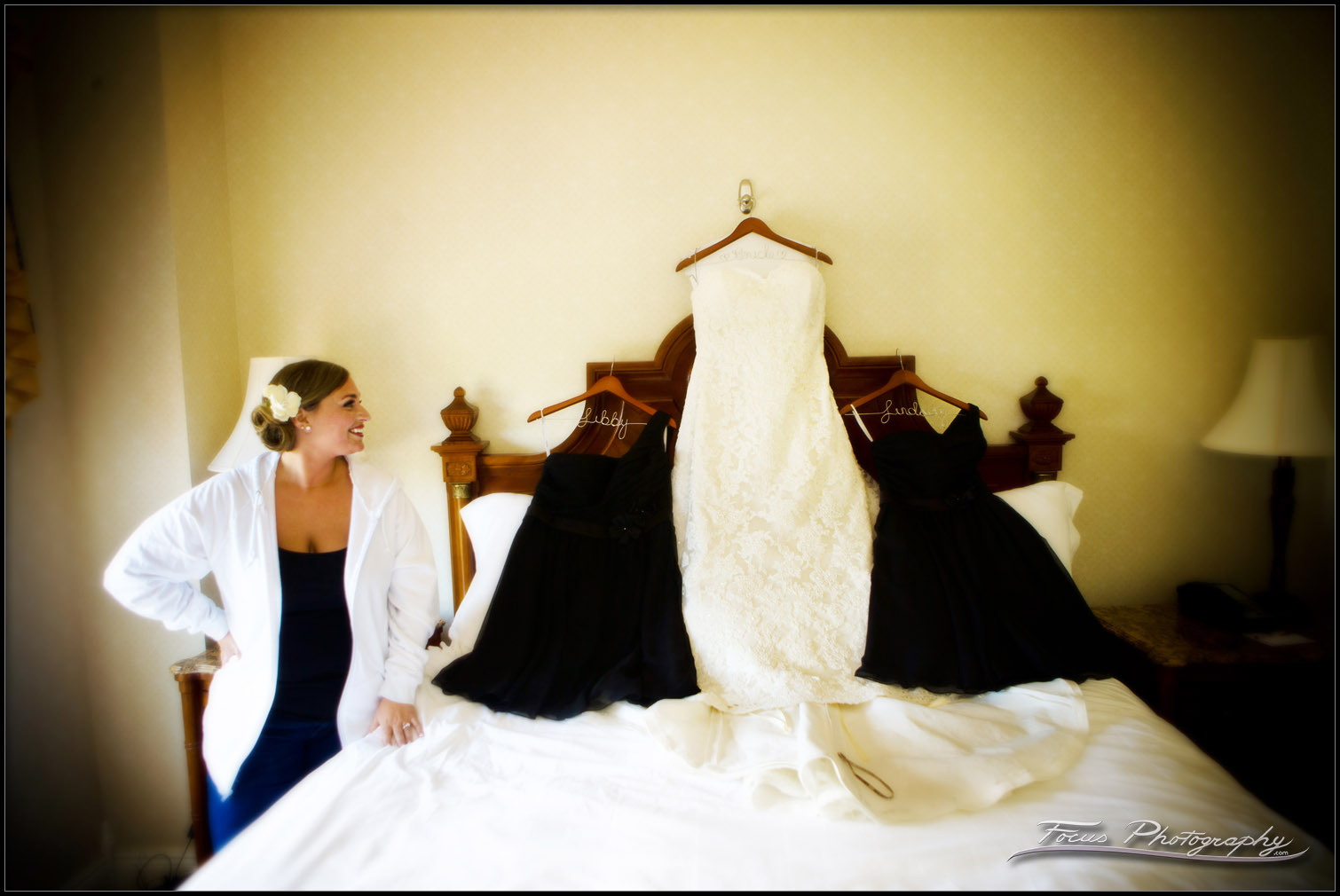 Bride admiring her dress choices.
