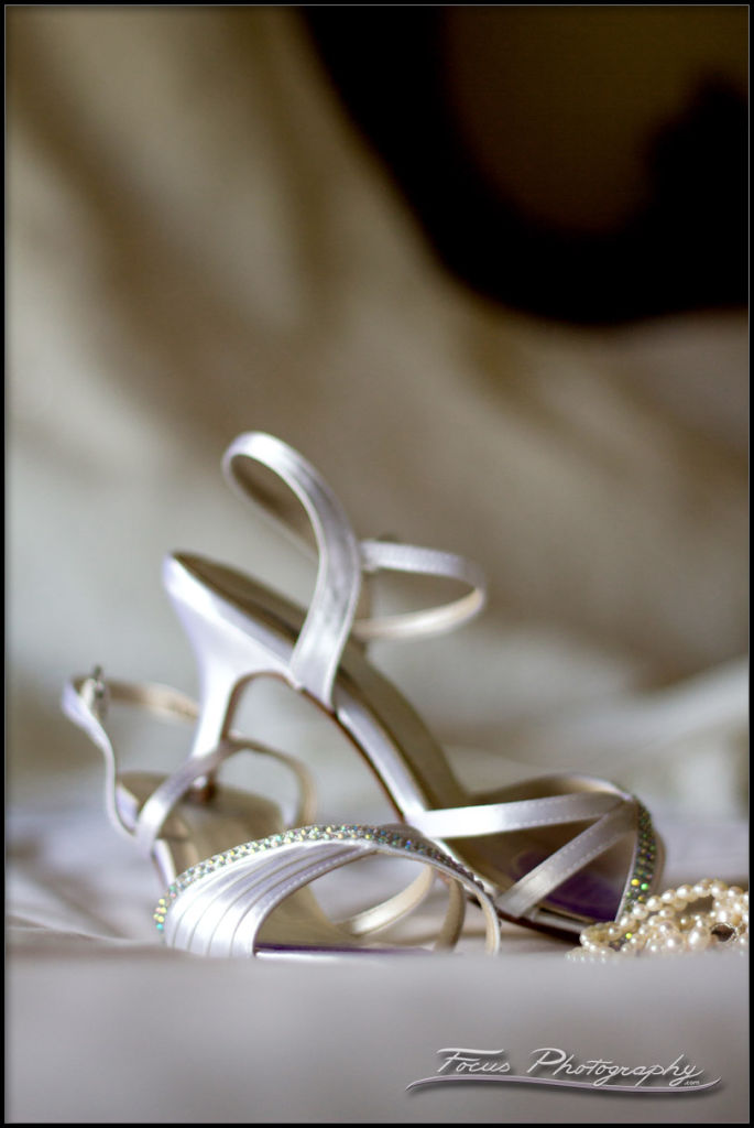 shoes and jewelry on wedding gown