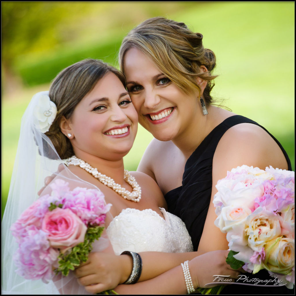 bride and maid of honor during wentworth wedding - photographers Will and Lucia of Focus Phtography