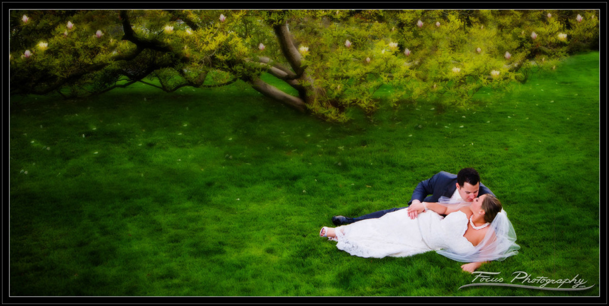 bride and groom in the garden at the Wentworth by the sea in New Castle, New Hampshire. Wedding photographers Focus Photography