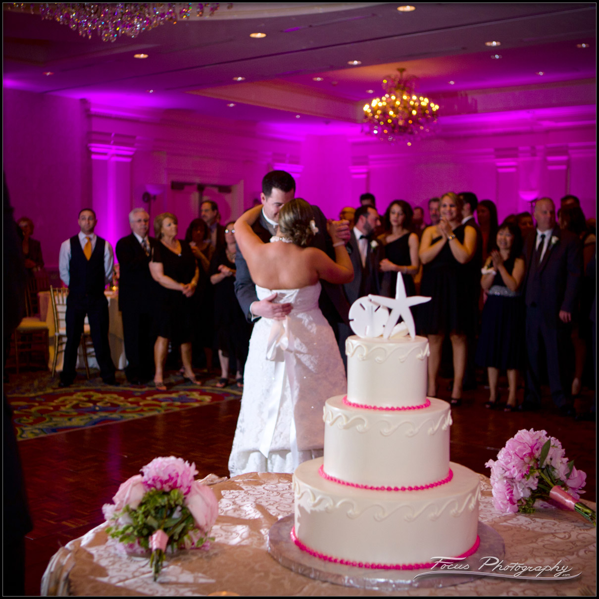 Bride and Groom dance with Wedding Cake