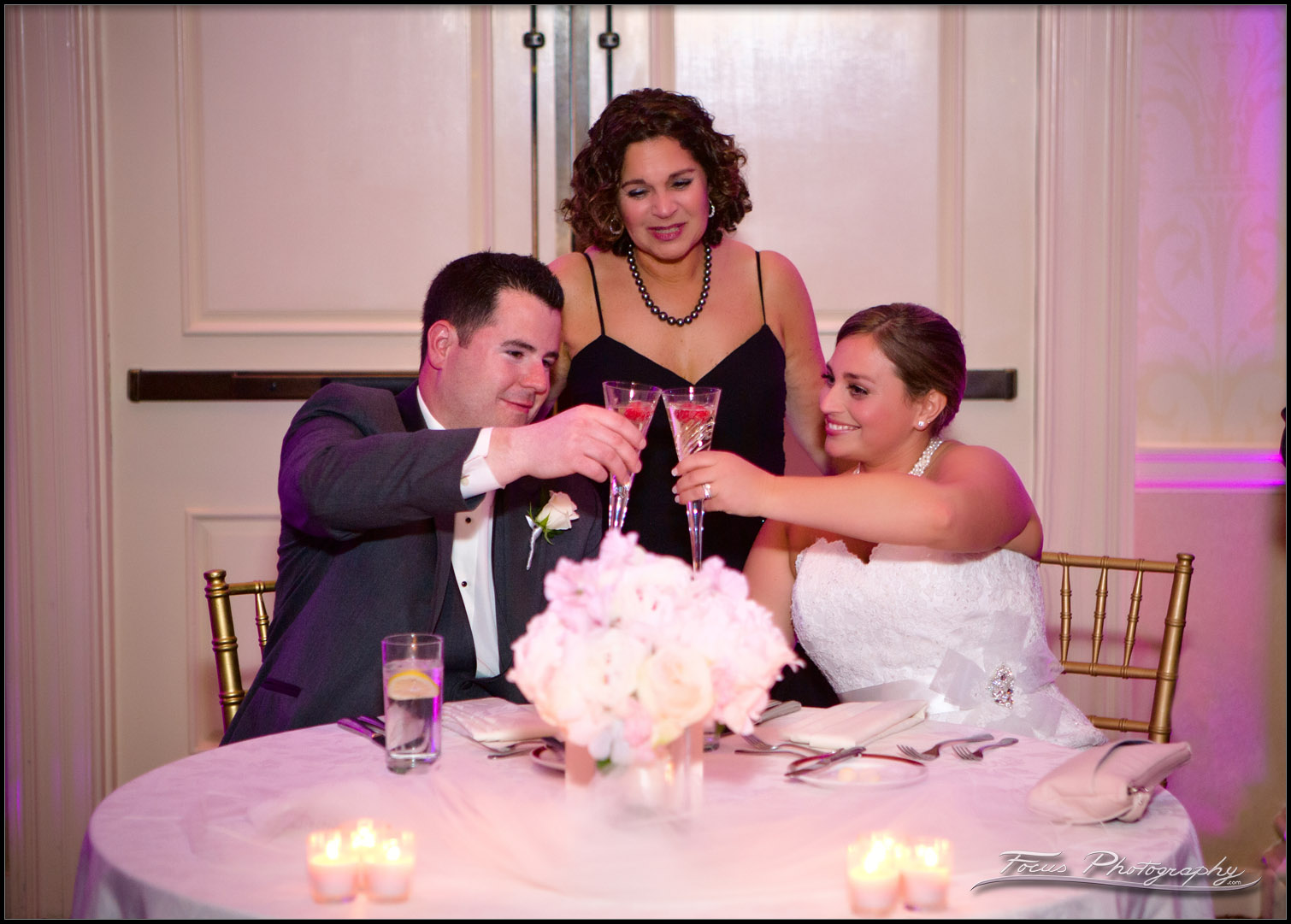Bride and Groom toast while mom watches