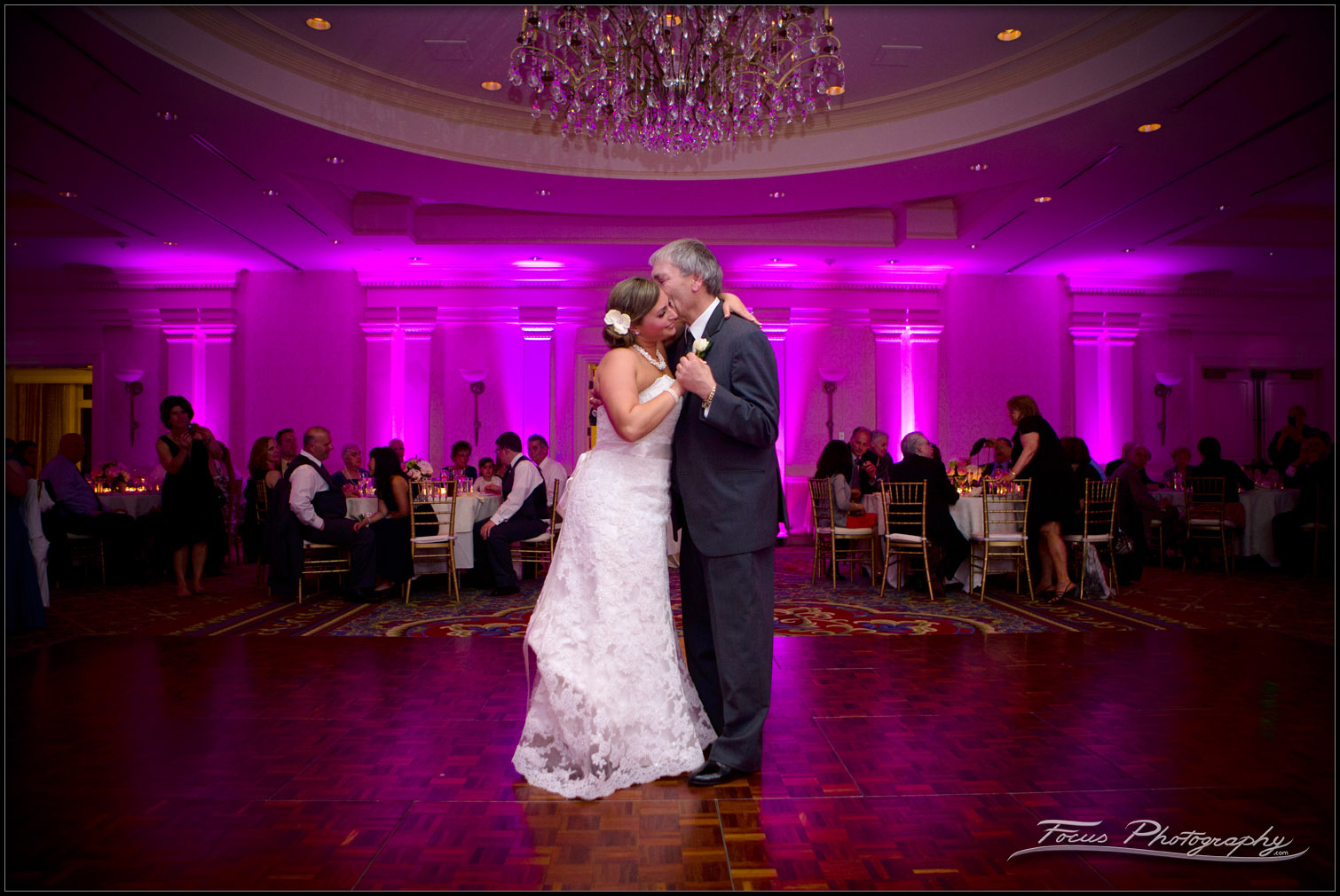 Bride dances with dad in ballroom