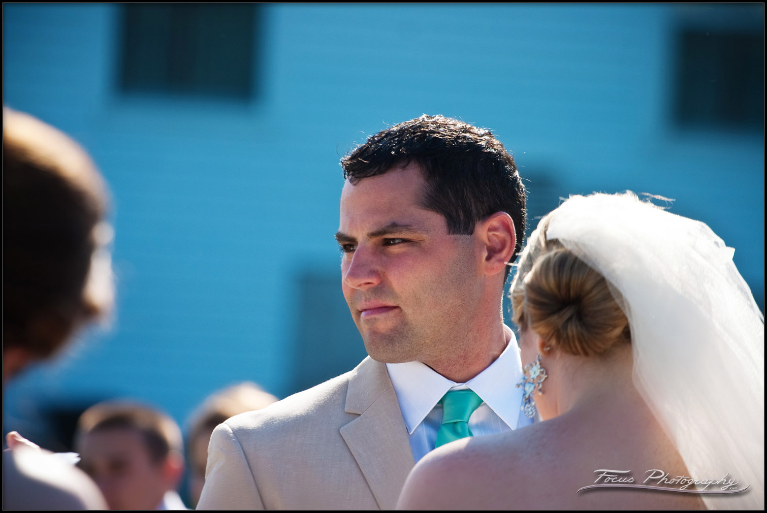 JT pays attention during the wedding ceremony at York Beach, Maine. Wedding photographers will and lucia of Focus