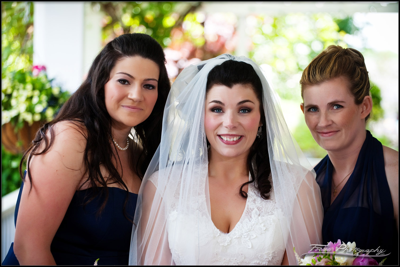 The two maids of honor with the bride