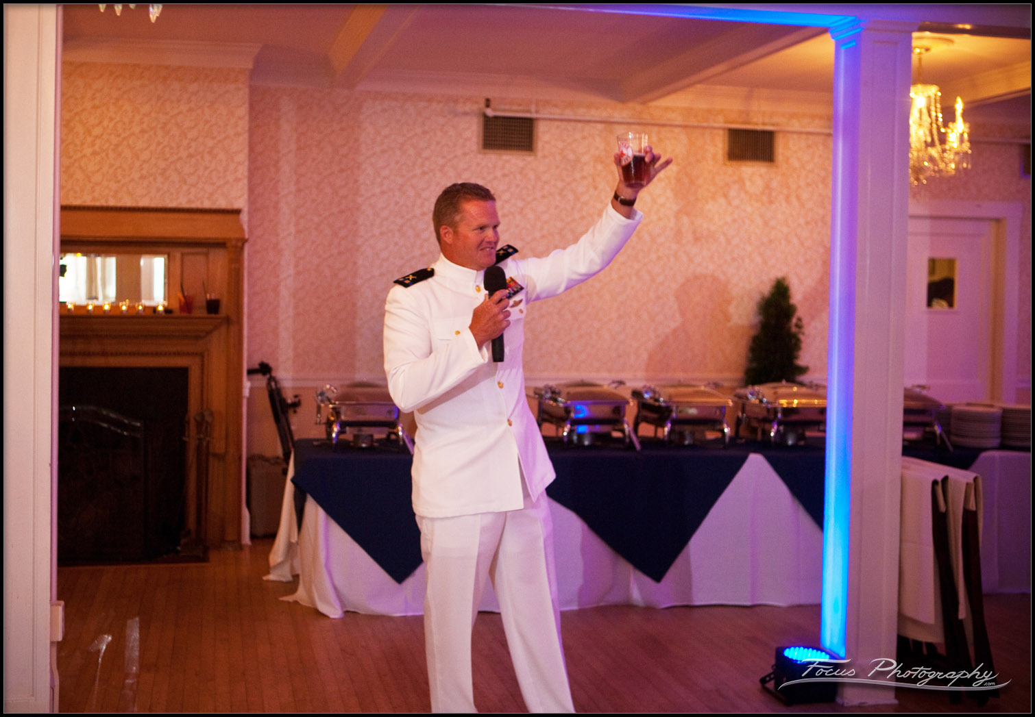 The best man toasts the bride and groom