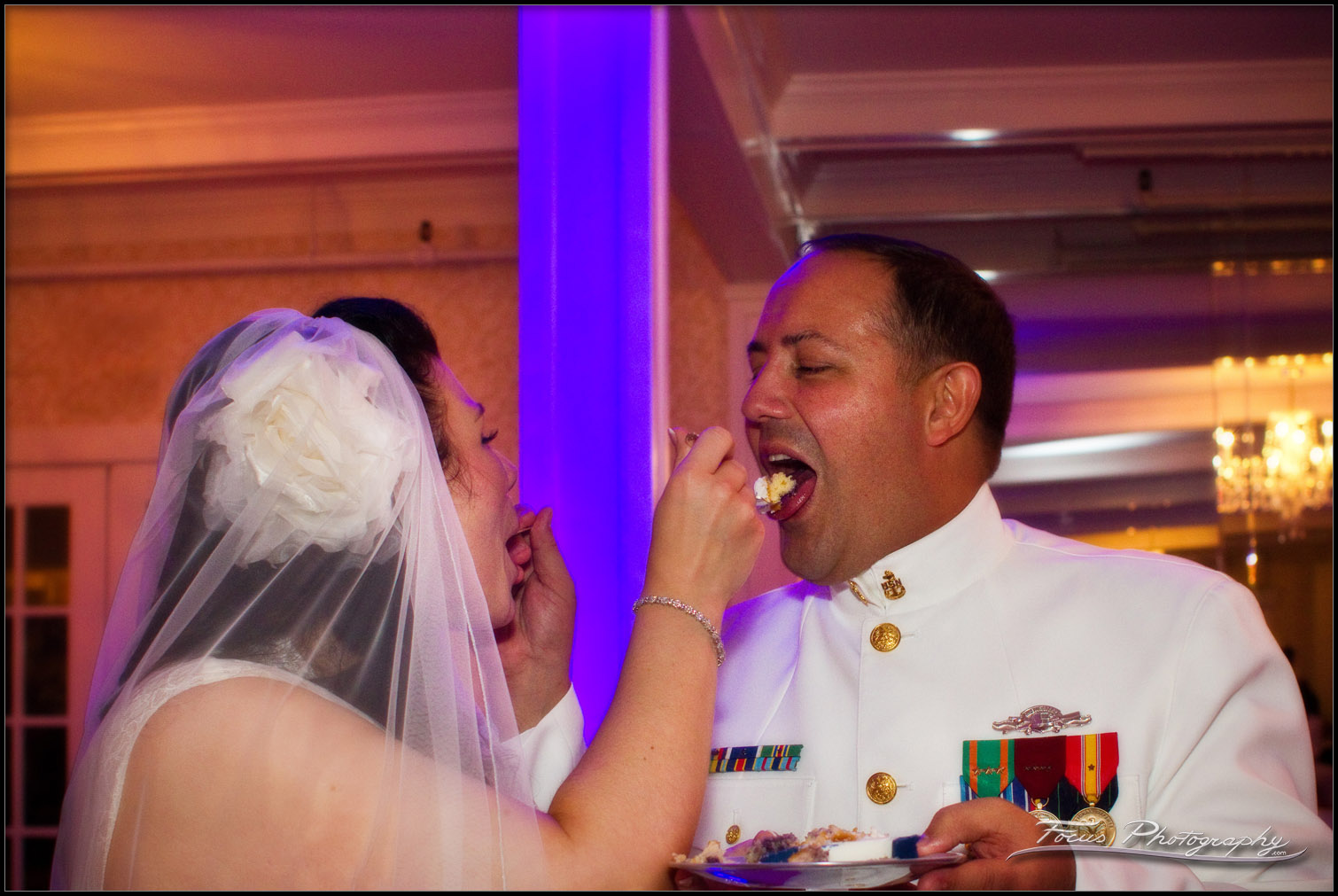 The bride and groom feed each other wedding cake
