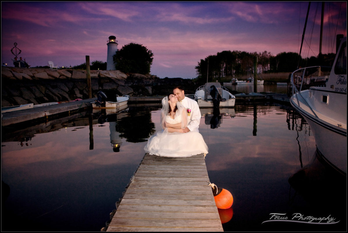 The bride and groom on the docks at Kennebunkport, Maine. Wedding photographers Will and Lucia