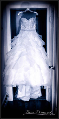 Bride's gown hanging in the doorway