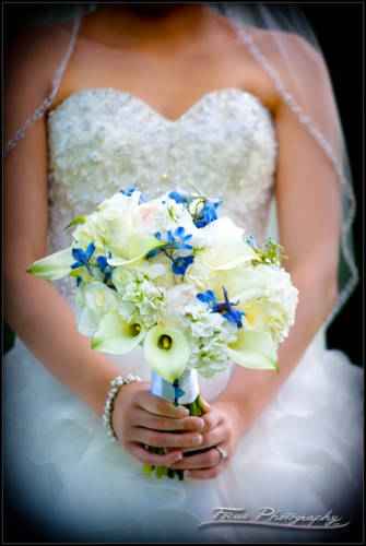 the bride holds her wedding bouquet