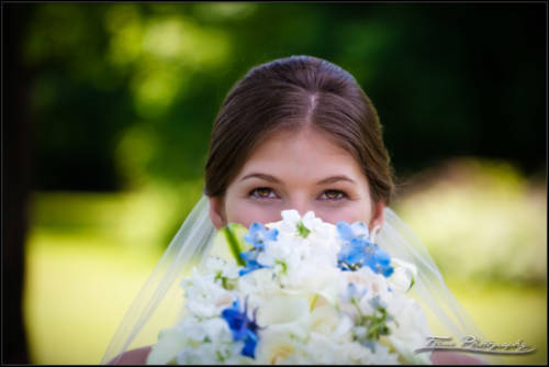 Kaitlin's eyes above her wedding bouquet