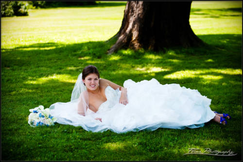 Kaitlin on the grass at maine wedding - photographers Will and Lucia of Focus Photography