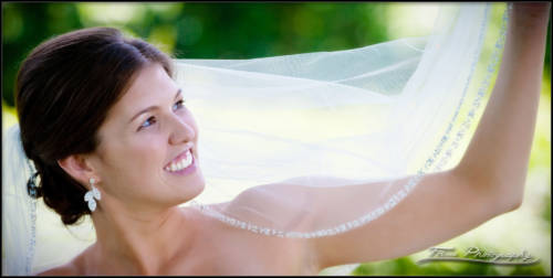 Bride holds up her wedding veil