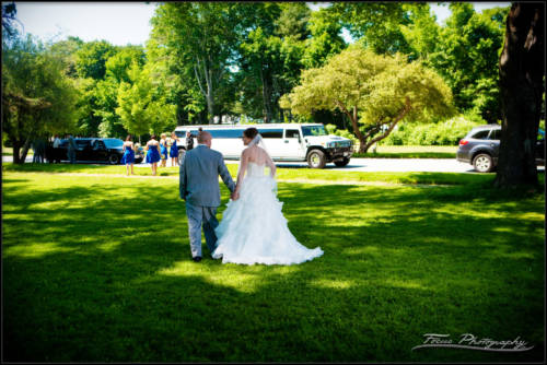 bride and groom walk to the limos to head to the wedding chapel