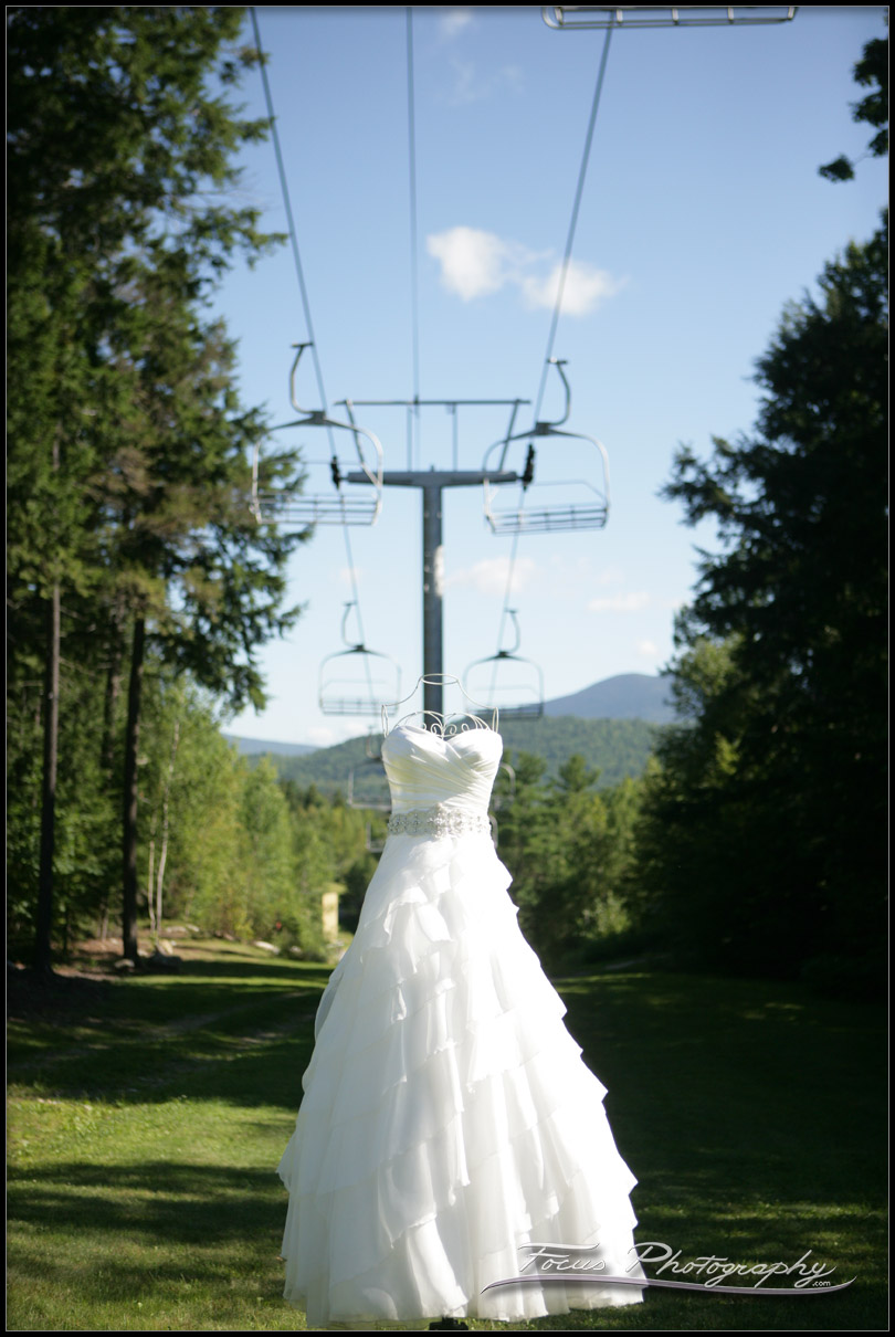 Gown under the chair lift at sunday river wedding